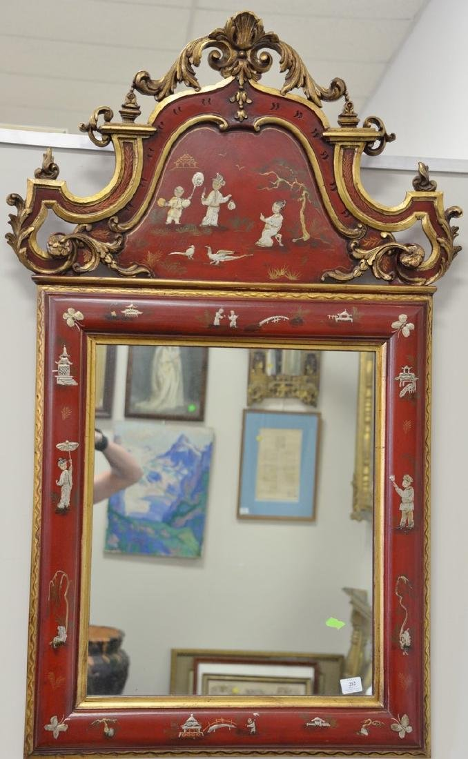 "Chinoiserie decorated red framed mirror. 55"" x 35"""
