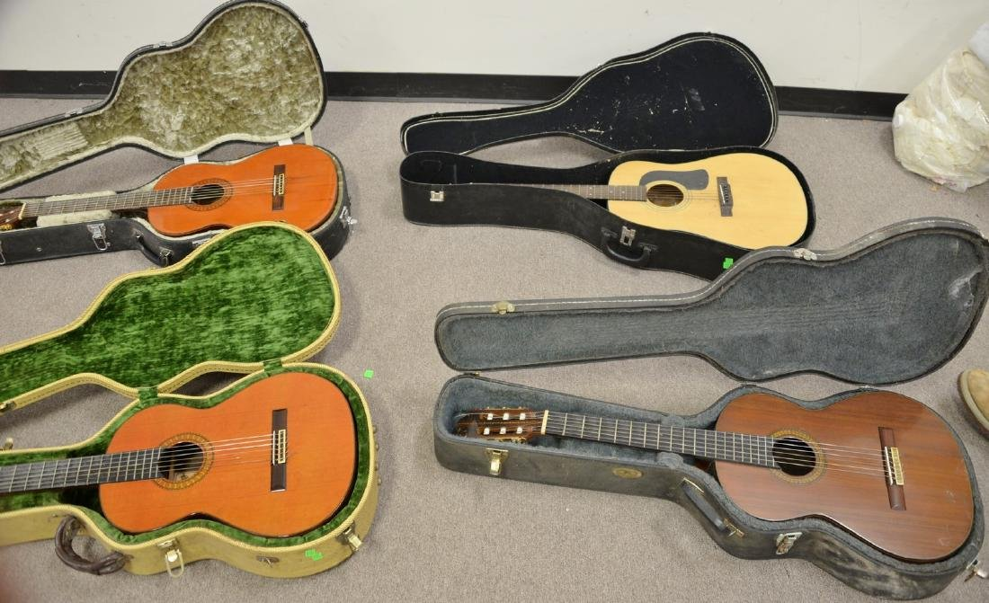 Four guitars in cases including Jose Ramirez, Ramirez