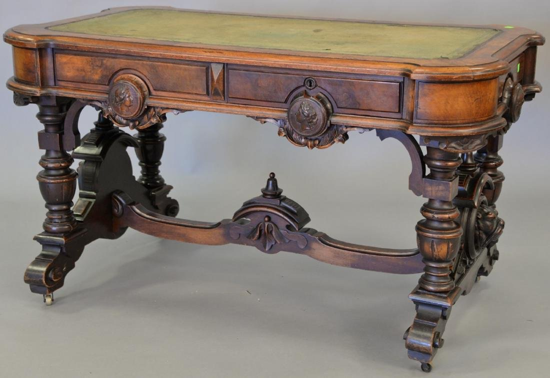 Walnut Victorian double writing table with carved