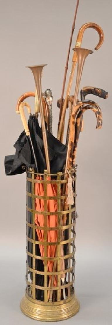 Brass umbrella holder (ht. 24in.) with canes and