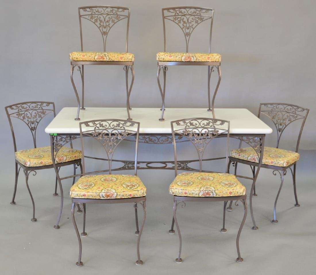 Iron patio table and six chairs, table topped with