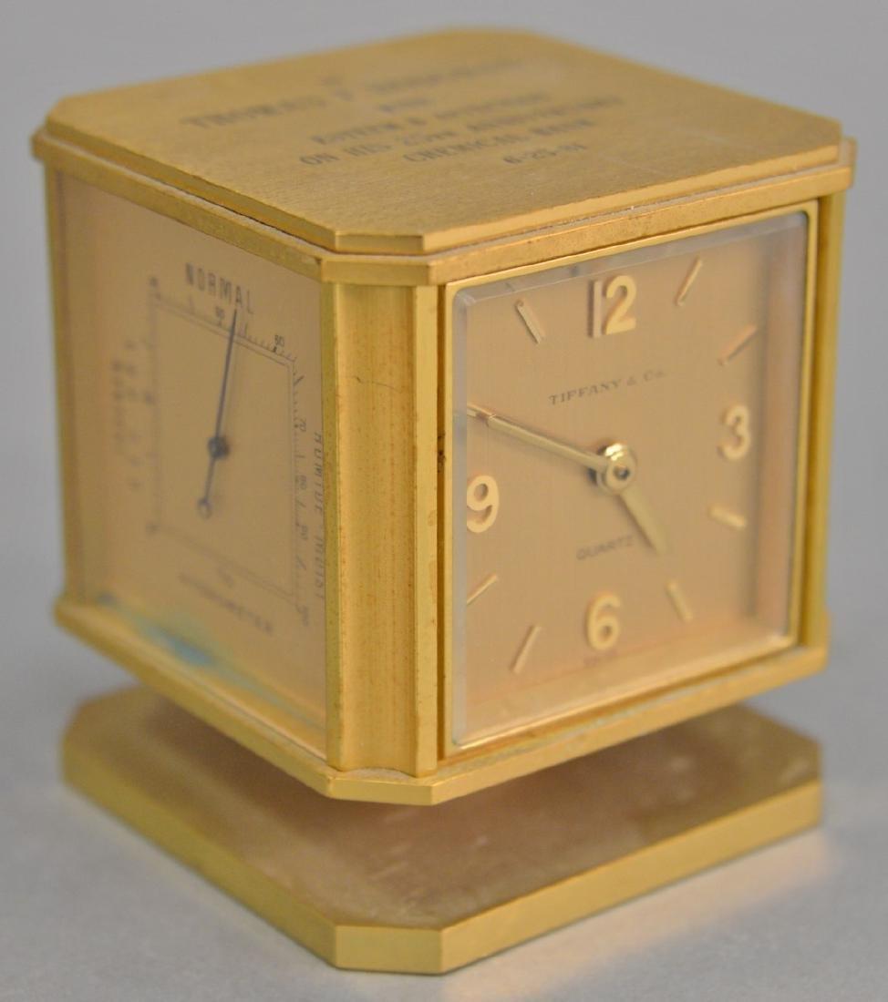 Tiffany & Co. brushed brass revolving clock barometer