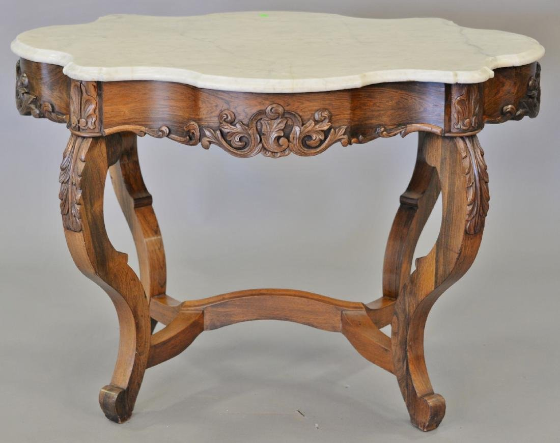 Rosewood Victorian shaped marble top center table. ht.