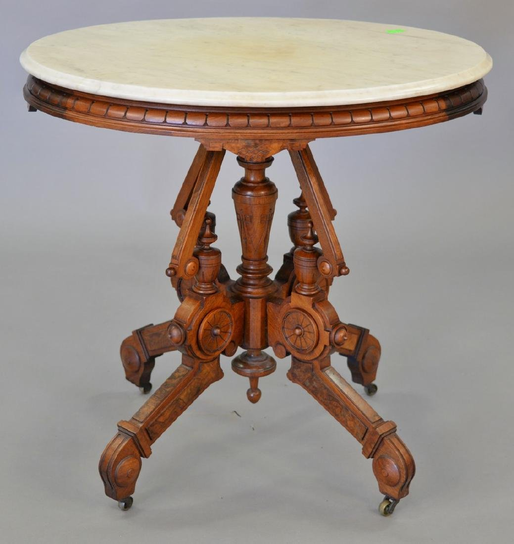"Victorian walnut oval marble top table. top: 24"" x 31"""