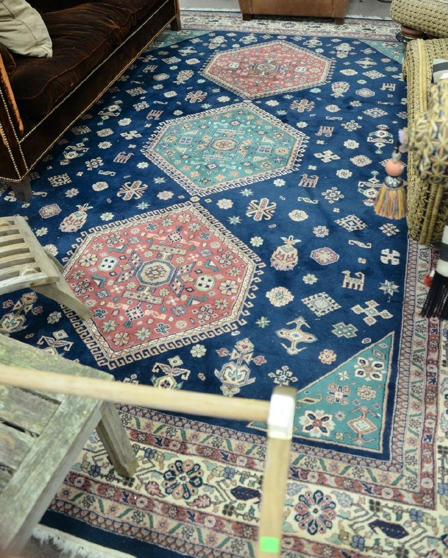 "Oriental carpet, 8'10"" x 11'9""."