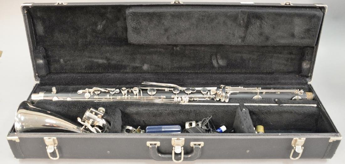 Armstrong G Bass clarinet in fitted box with stand.