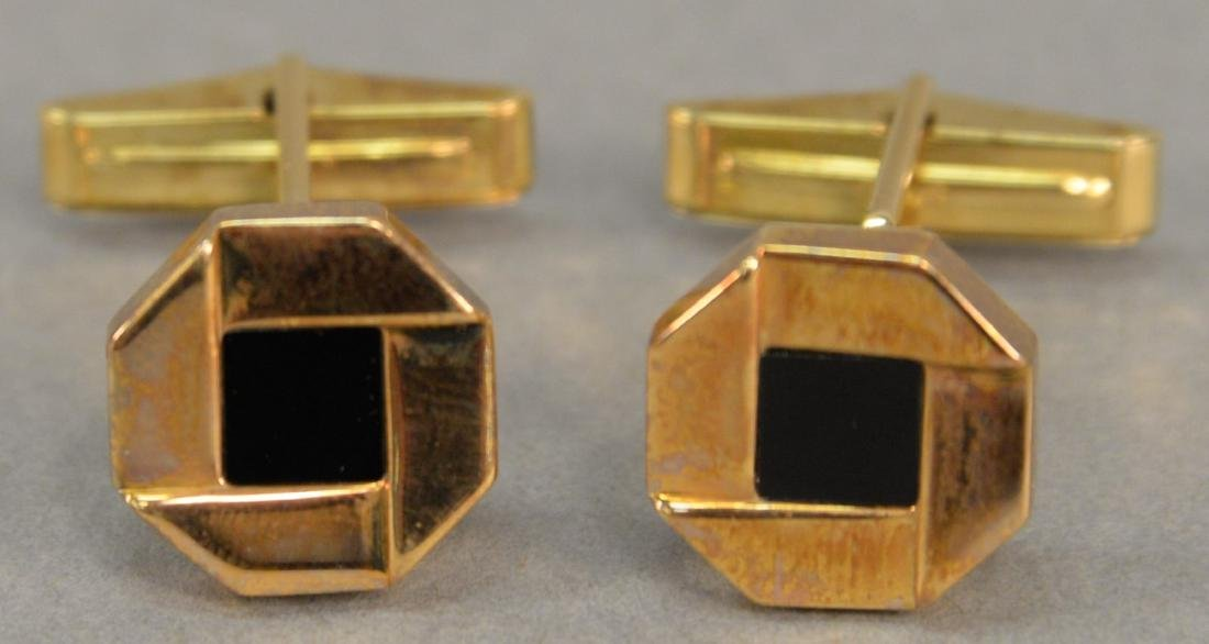 "Pair of 18 karat gold cufflinks, ""Chase"", with black"
