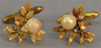 Pair of 14 karat gold cufflinks each set with pearl