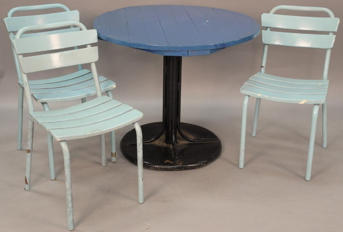 Four piece outdoor set to include a round metal table