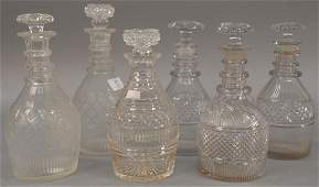 Group of six crystal decanters including two pairs and