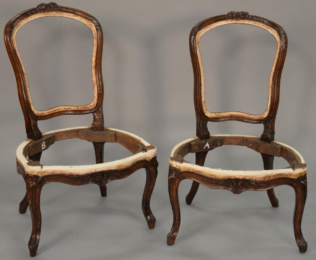 Pair of Louis XV style side chairs with floral carved