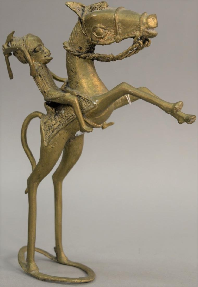 African brass horse and rider sculpture. height 12