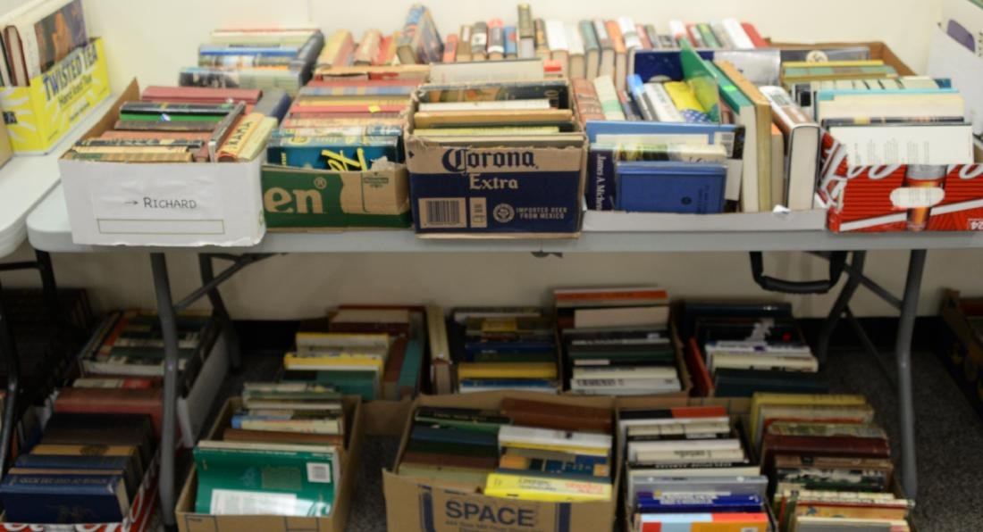 Table lot of books, on top and below table to include a