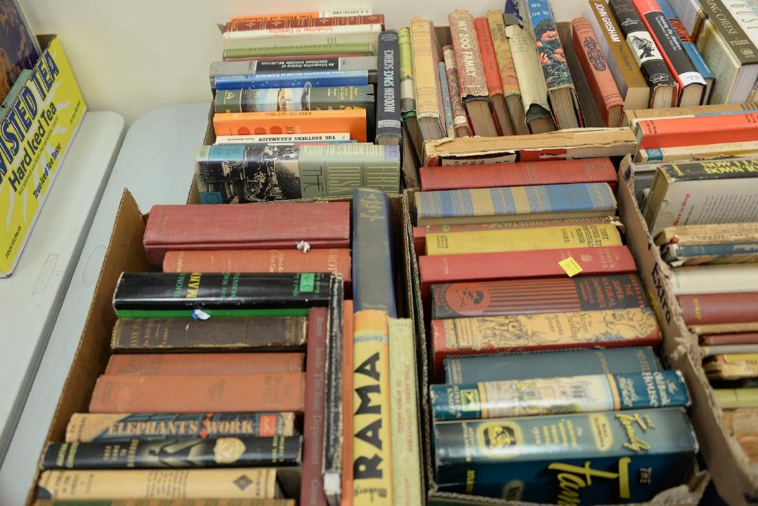Table lot of books, on top and below table to include a - 2