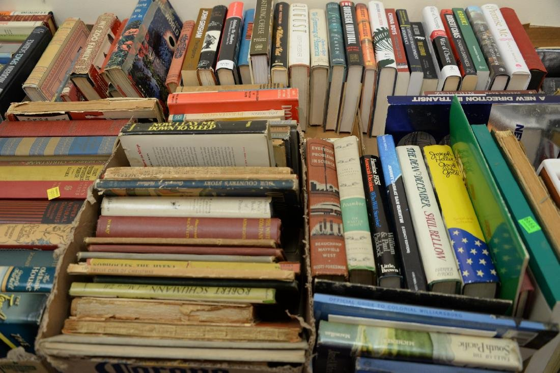 Table lot of books, on top and below table to include a - 3