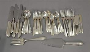 Kirk and Sons sterling silver partial flatware set to