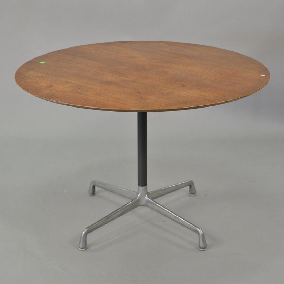 Eames walnut round top table. ht. 28in., dia. 41 1/2in.