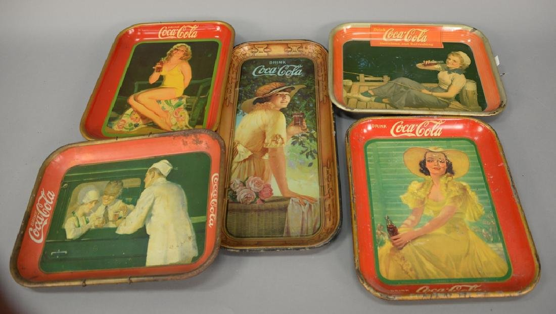 Group of five original Coca-Cola tin advertising trays.