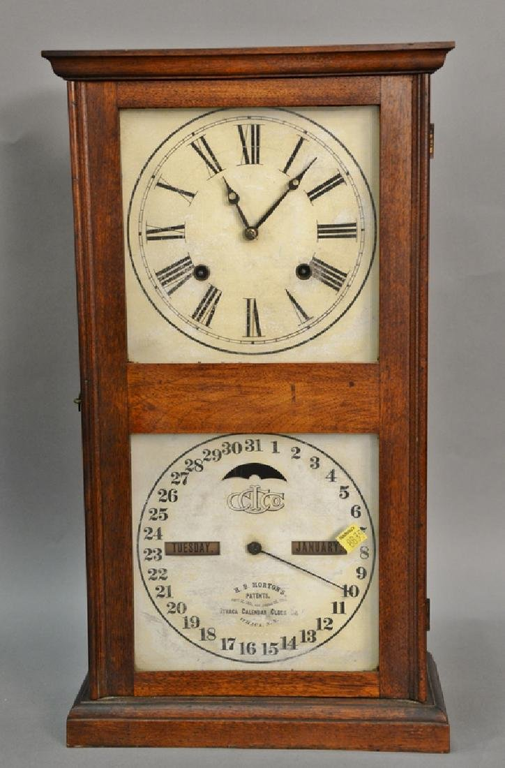 Ithaca double dial calendar clock. ht. 21in.