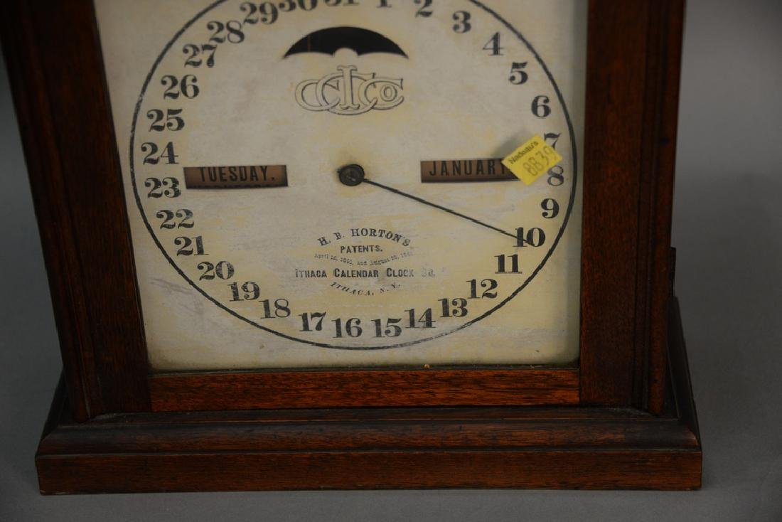 Ithaca double dial calendar clock. ht. 21in. - 2