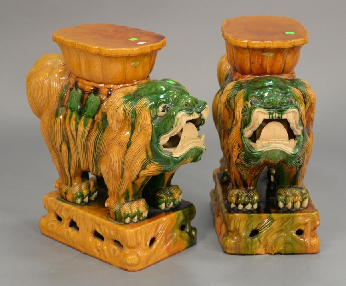 Pair of glazed foo dog garden seats. ht. 22in., lg.