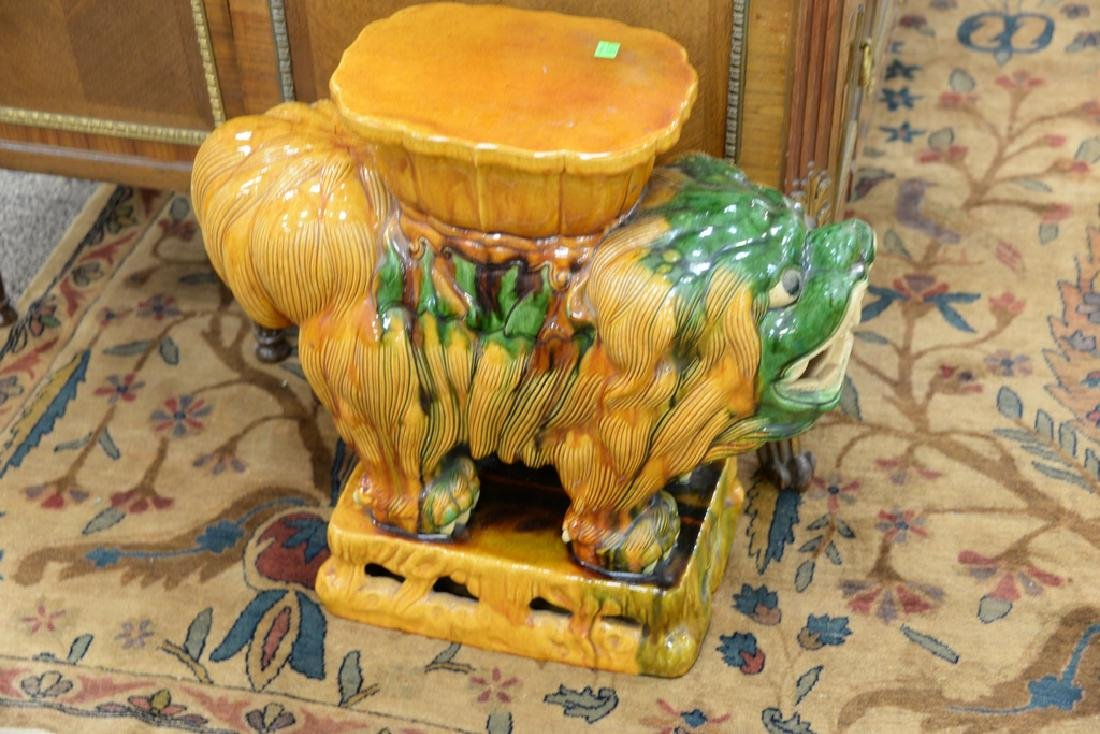 Pair of glazed foo dog garden seats. ht. 22in., lg. - 3