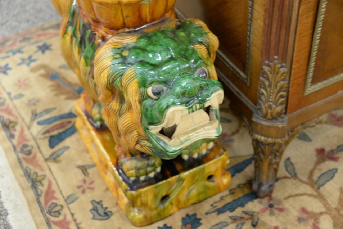 Pair of glazed foo dog garden seats. ht. 22in., lg. - 4