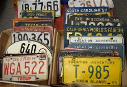 Two box lots of thirty-four vintage license plates from