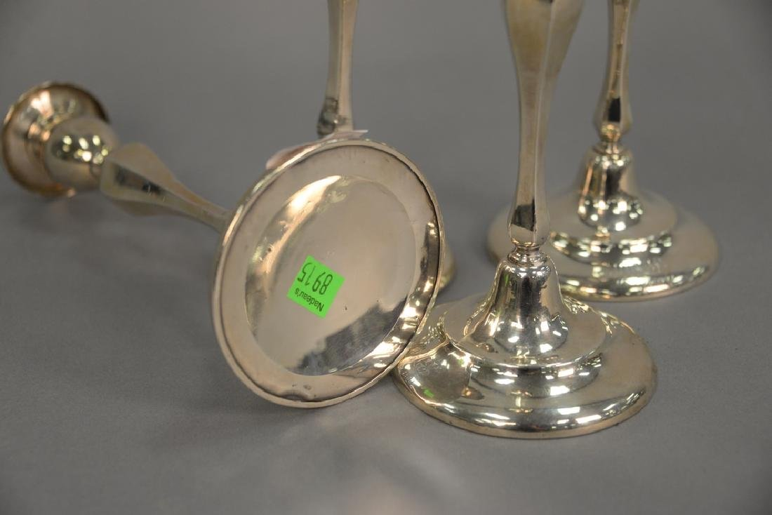 Set of four sterling weighted candlesticks (as is), ht - 4