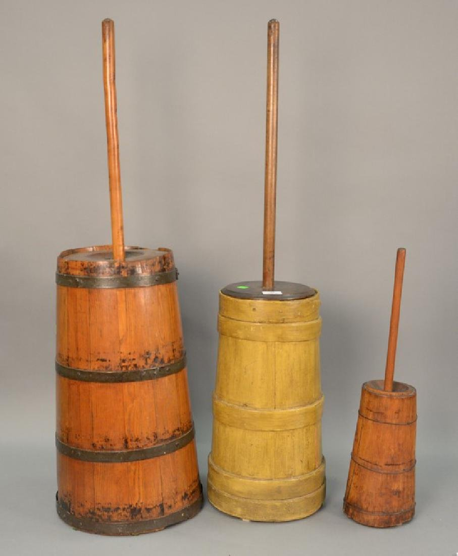 Three primitive butter churns, ht