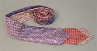 Assorted group of three Hermes silk ties wd 3 12in