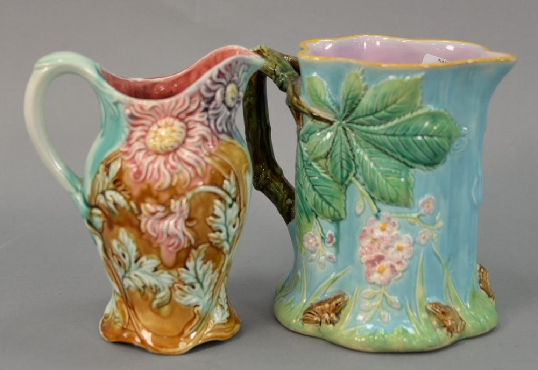 Two Majolica pitchers Frie Onnaing 812 floral pitcher