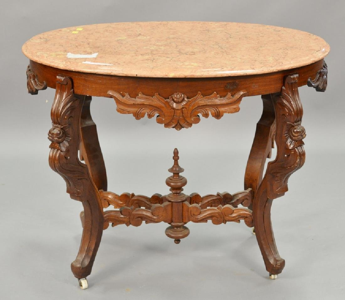 Victorian oval marble top center table with light rouge