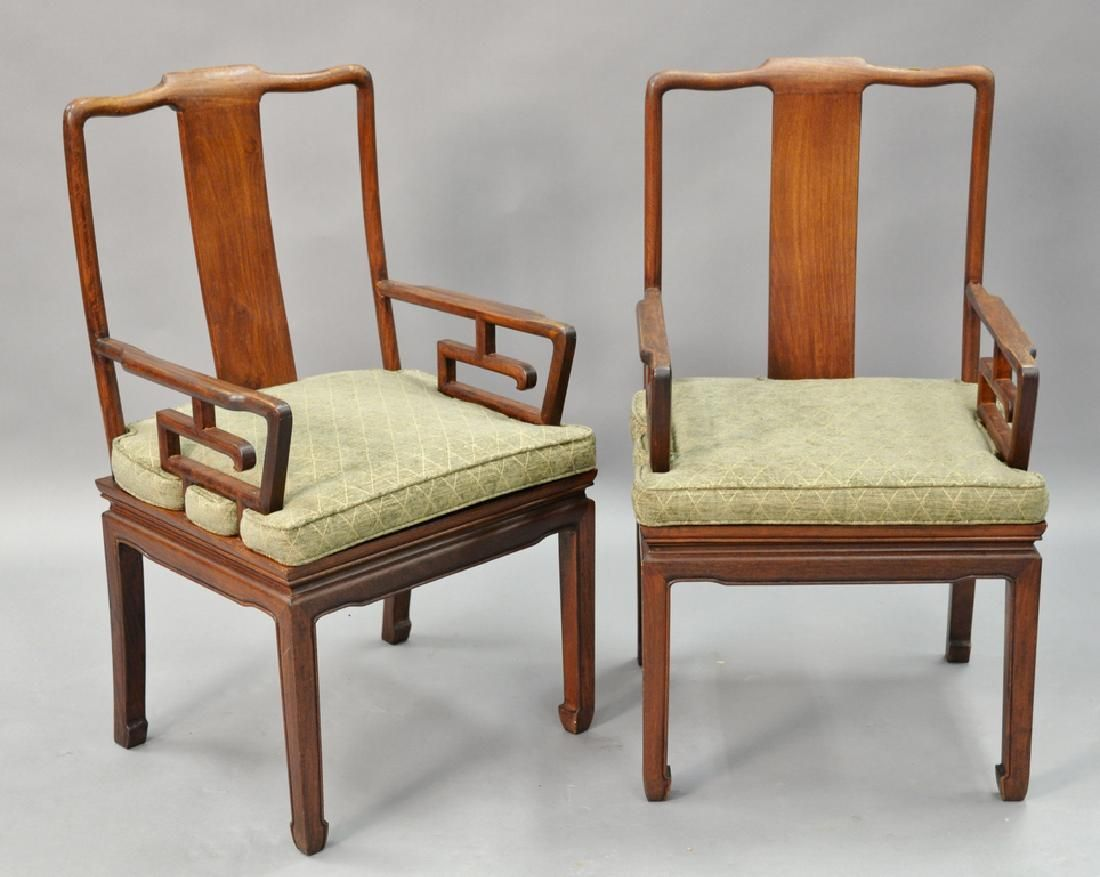 Pair of Chinese hardwood armchairs.