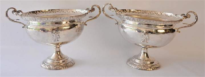Pair of silver urns each with handles on round footed