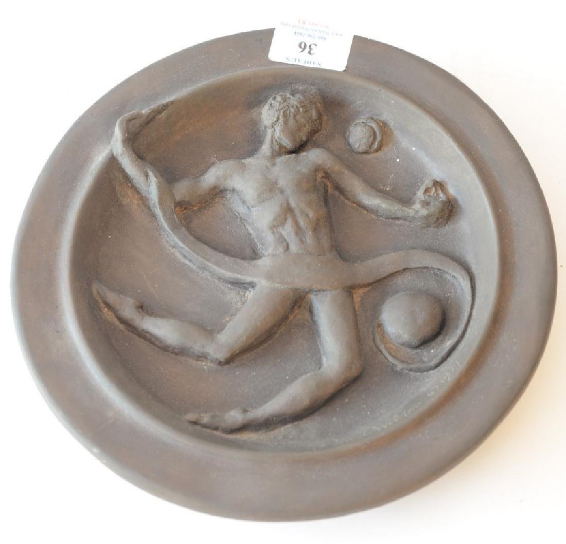 Bronze disk with classical three dimensional figure,