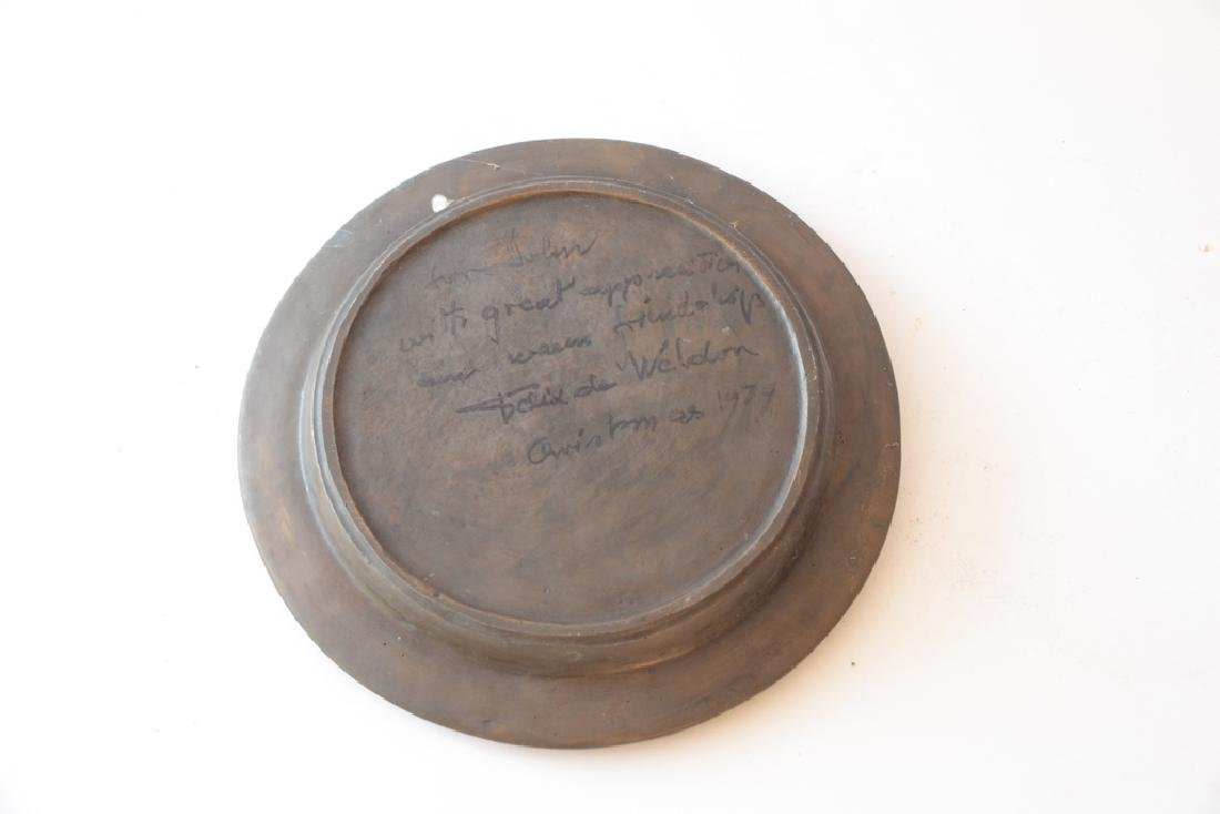Bronze disk with classical three dimensional figure, - 3