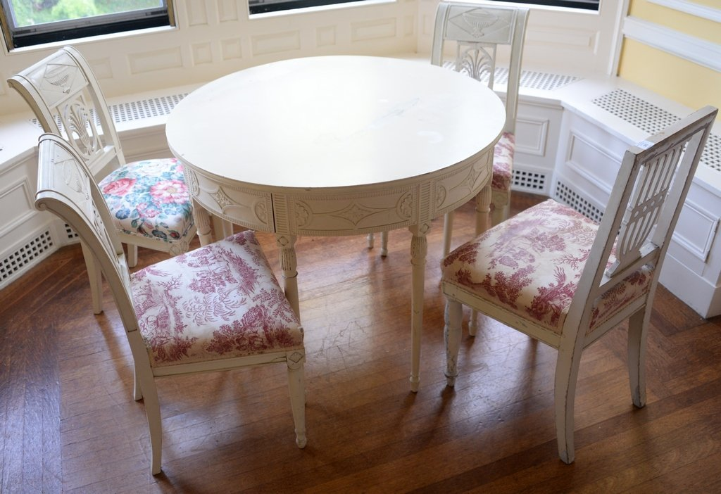 White painted table and four chairs (one non matching).