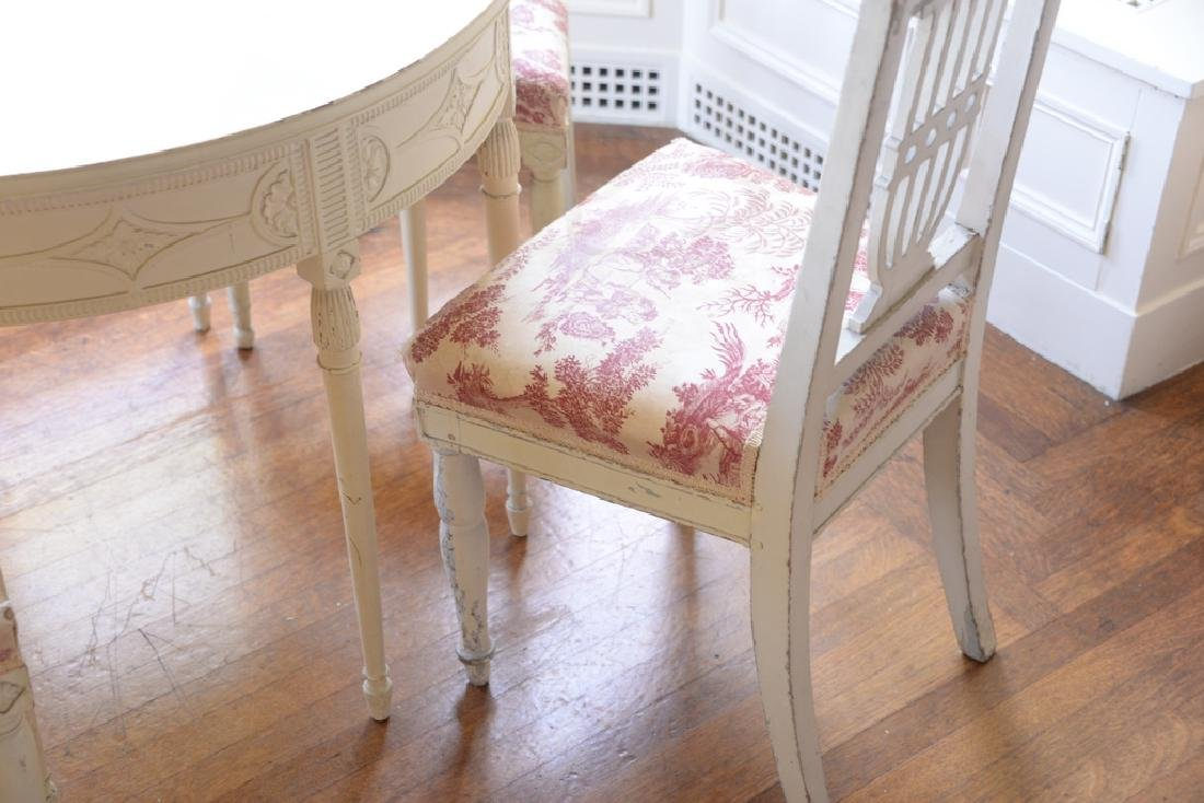 White painted table and four chairs (one non matching). - 2