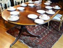 Custom mahogany oval double pedestal dining table with