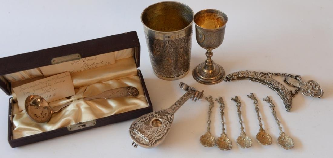 Group of silver and sterling to include, ladle, cup,
