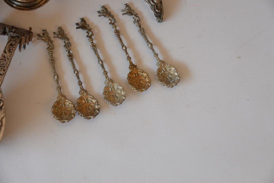 Group of silver and sterling to include, ladle, cup, - 2
