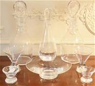 Group of eight Steuben crystal pieces to include a pair