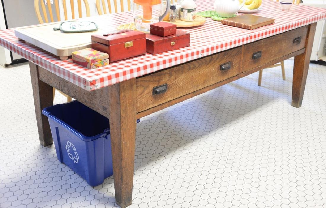 Large oak farm style table having two drawers on either
