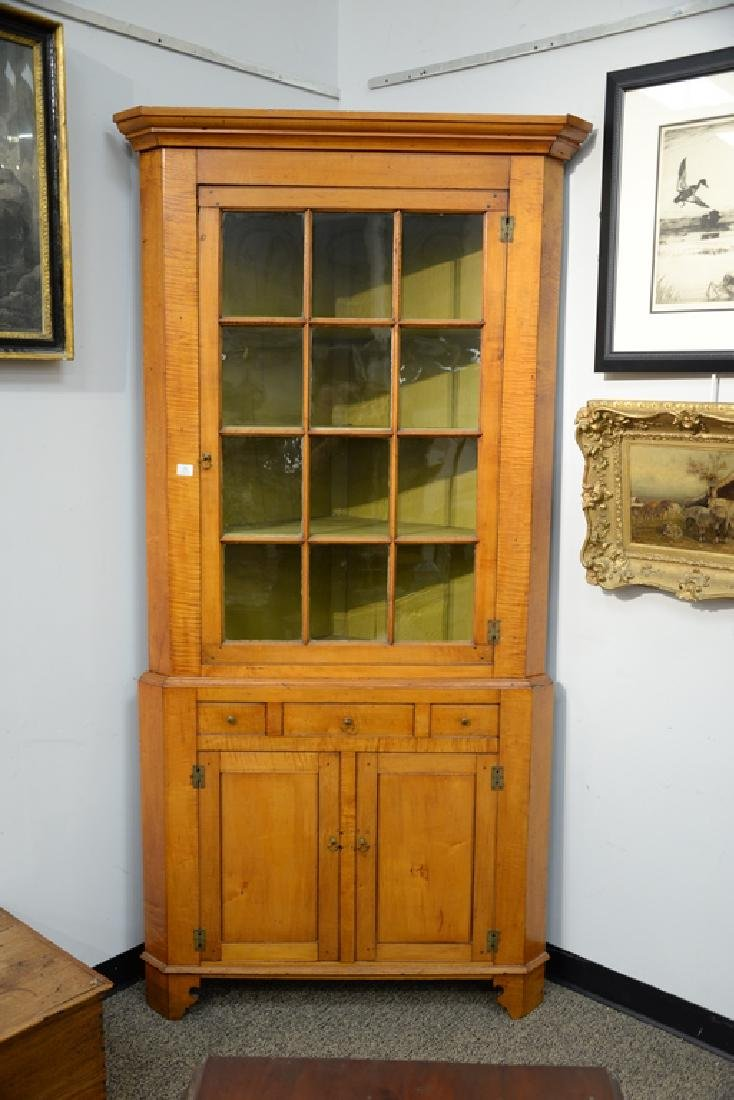 Maple and tiger maple two part corner cupboard.  height - 2