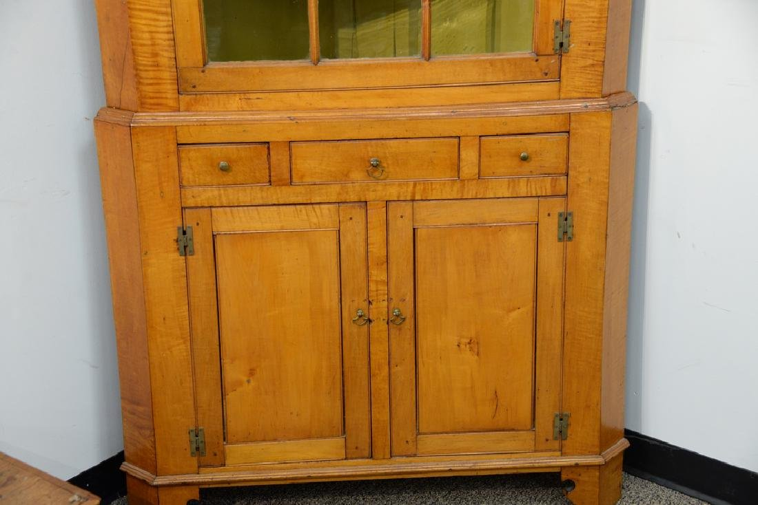Maple and tiger maple two part corner cupboard.  height - 4