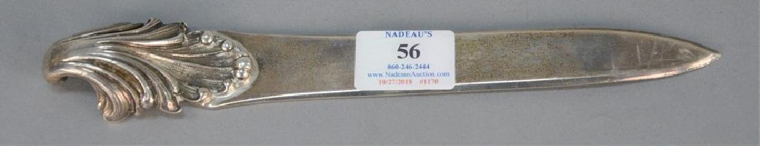 Buccellati silver letter opener with scrolled handle.