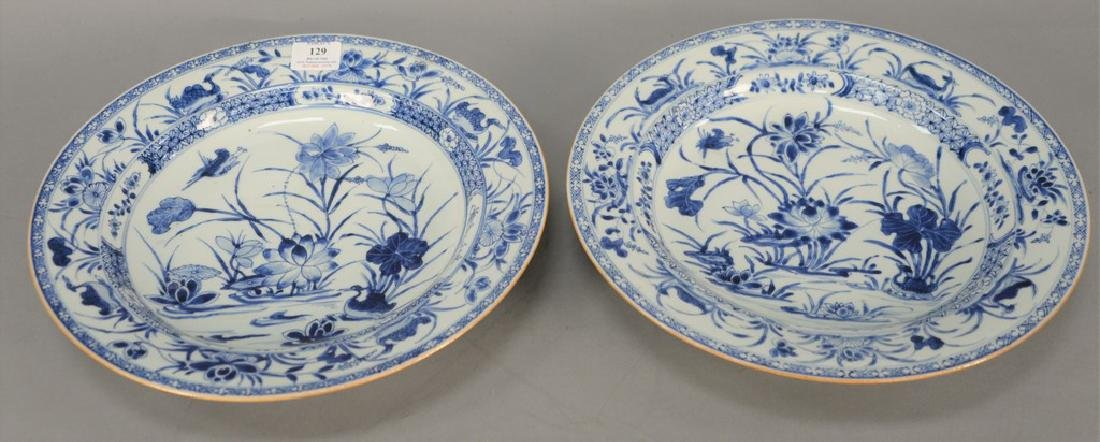 Pair of large blue and white porcelain deep chargers