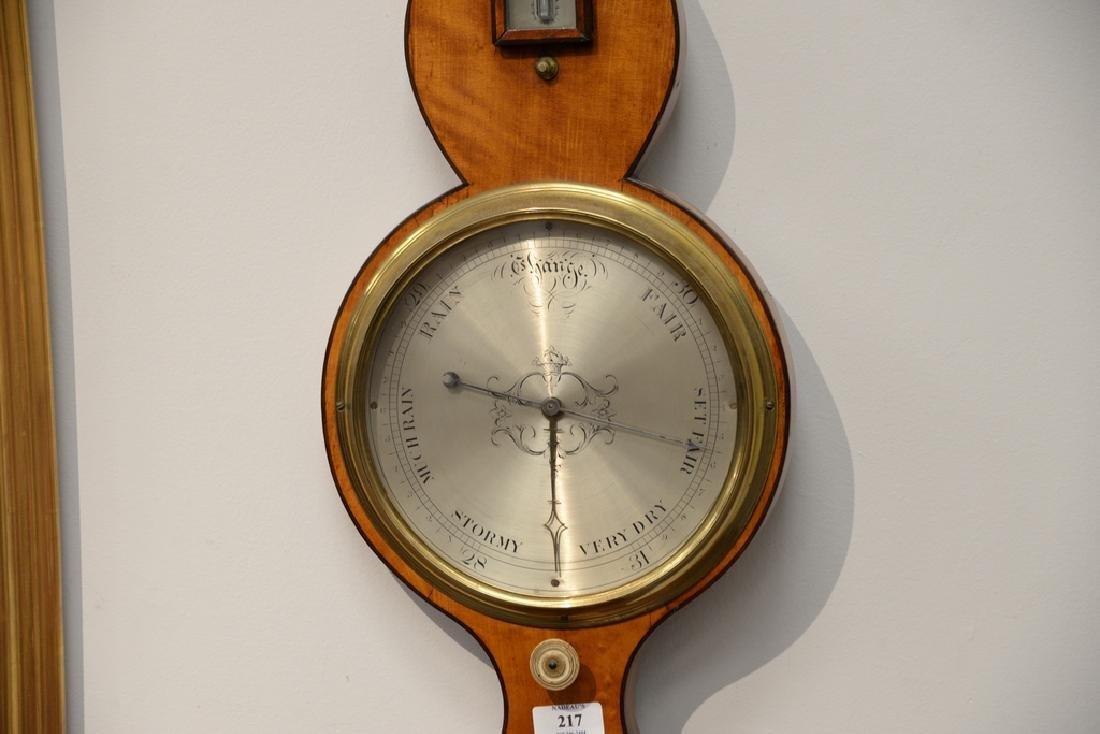 Satinwood wheel barometer.  height 38 in. - 2