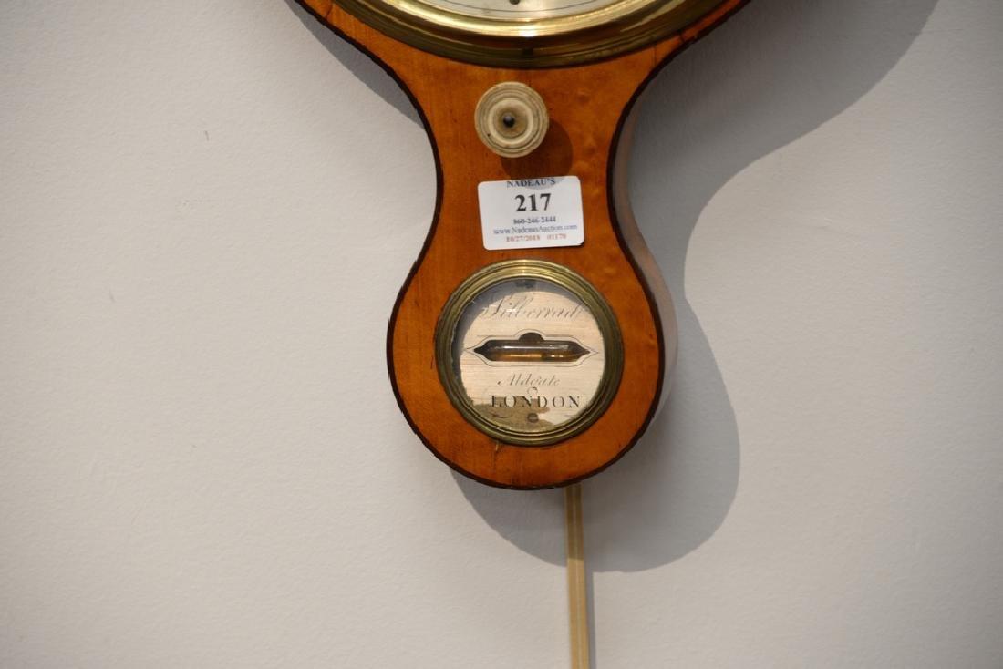 Satinwood wheel barometer.  height 38 in. - 3